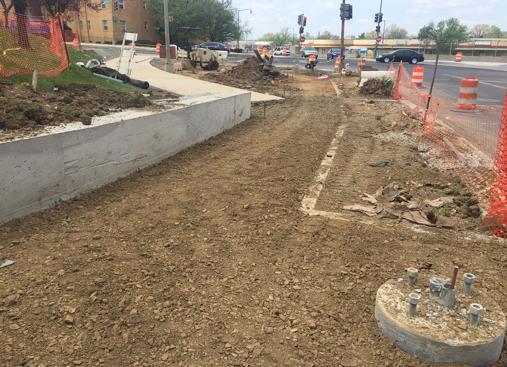 New sidewalk and retaining wall construction @ the SE corner of Minn. Ave. & Ridge Rd.