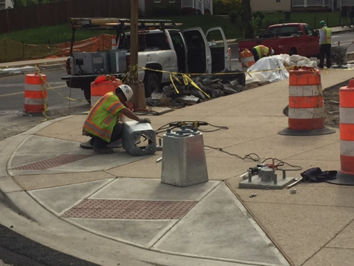 Installation of traffic signal/streetlight pole bases @ the SE corner of Minn. Ave. & Ridge Rd.