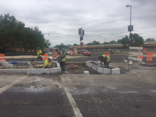Construction of new median and pedestrian ramp @ Minn. Ave. & Ridge Rd.