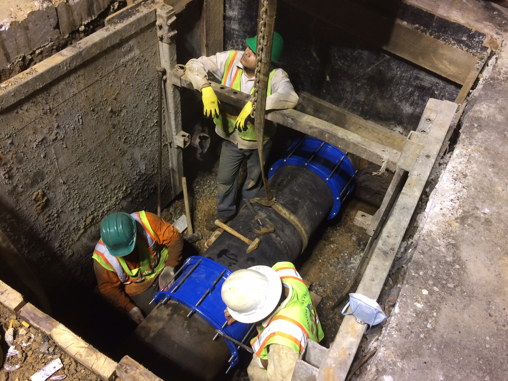 "Reconnecting/coupling existing 20"" water main after removal of 8"" valve, W/S b/t Benning Rd & Dix St"