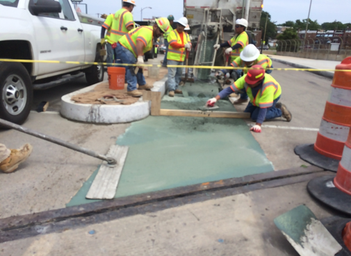 Bridge deck repair using latex modified concrete