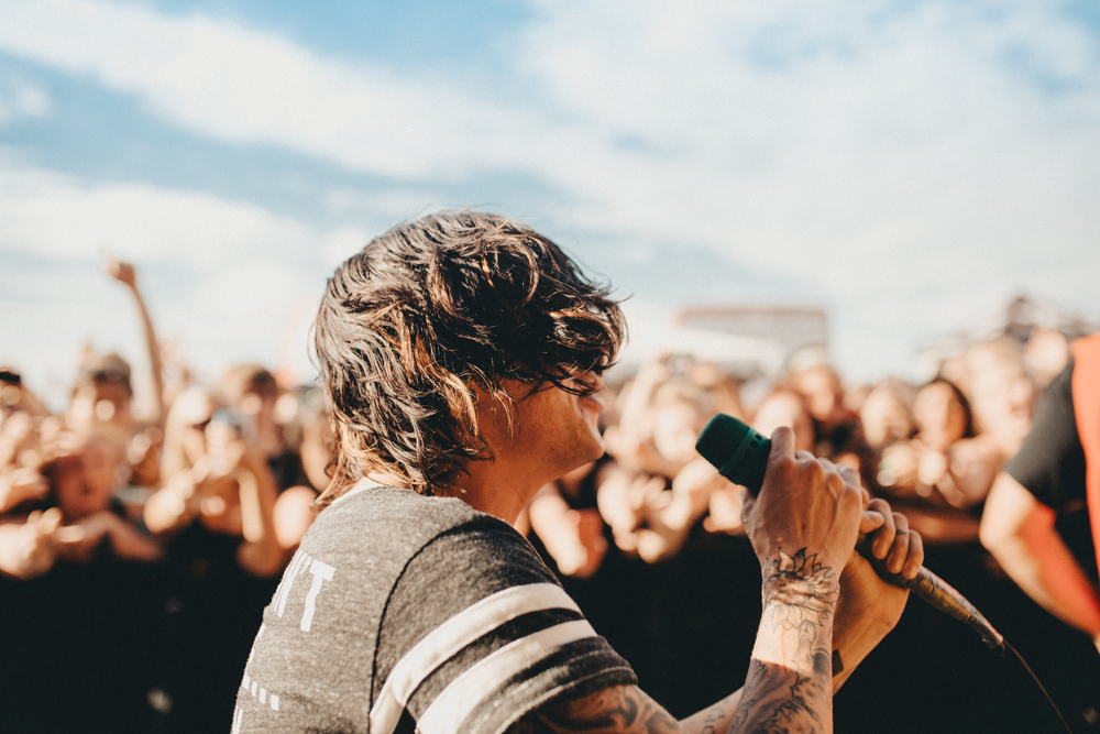 "Detroit, MI.  Nick always goes into the photo pit during, ""Go Go GO"" but boy... it is a whole unexpected event when Kellin goes in . I love the shots we get from it"