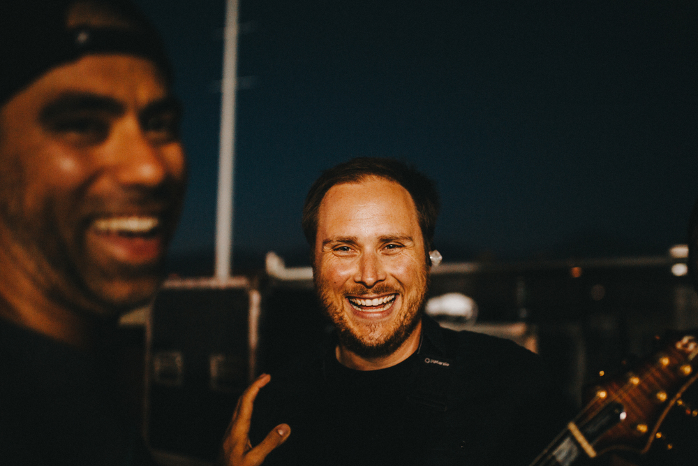 Pomona, CA . Ryan Mendez sharing a laugh with Cyrus Bolooki who is New Found Glory's drummer as well as the sit in drummer for Yellowcard.  Two legends, one photo