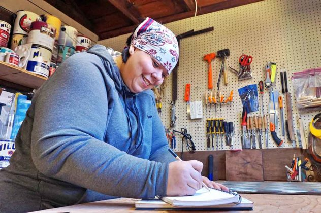 Cindy Seger sketches a new drawing of her next wood creation in her home woodworking studio in Tigard, Oregon.