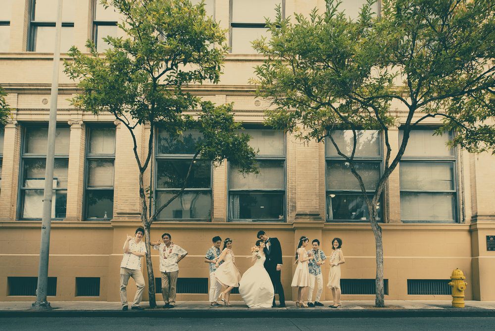 Bride and groom with family in downtown Honolulu Hawaii