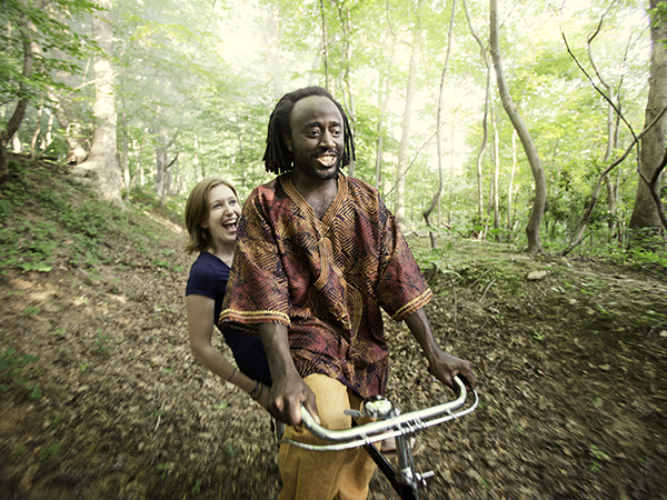 Molly Burke and Muyambi Muyambi ride together in Bethesda, Maryland.