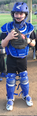 Image of young boy in a catchers outfit