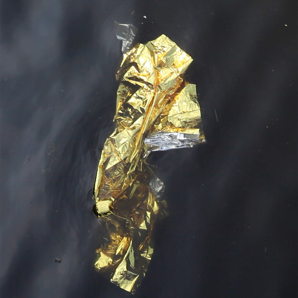 Blanket (2017) digital video still, mylar survival blanket and River Lea