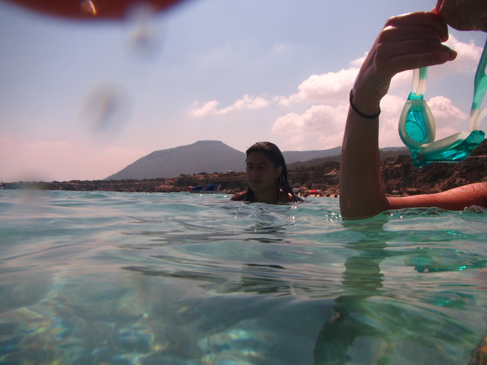 Dipping in the crystal Paphos waters.