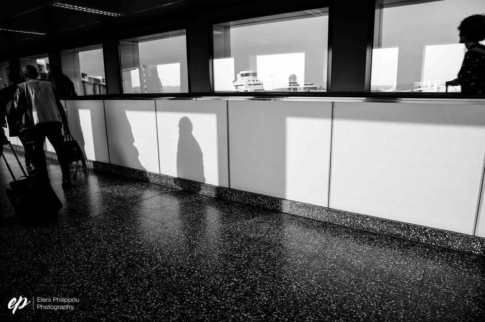 The first acquaintances in Italy: shadows figures in Milan airport