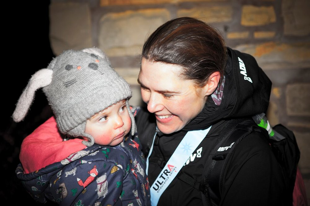 Jasmin Paris is reunited with 14-month-old daughter Rowan after the race (Credit: Yann Besrest-Butler/Montane Spine Race)
