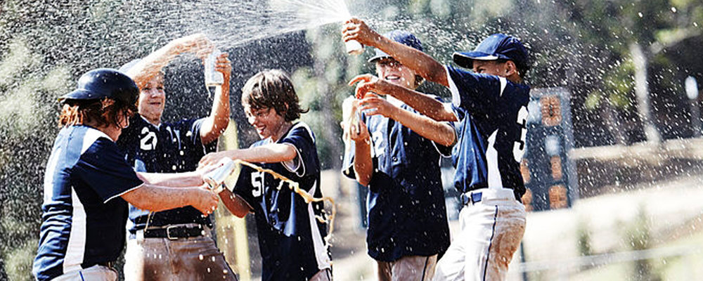 Scene 2: I want to create visuals that look good in slow motion. Adding a flying particulate such as liquid , dust or dirt will add visual interest to these shots. Here is an example of  the boys spraying a beverage. Dumping the Gatorade cooler on the coach is always a classic.