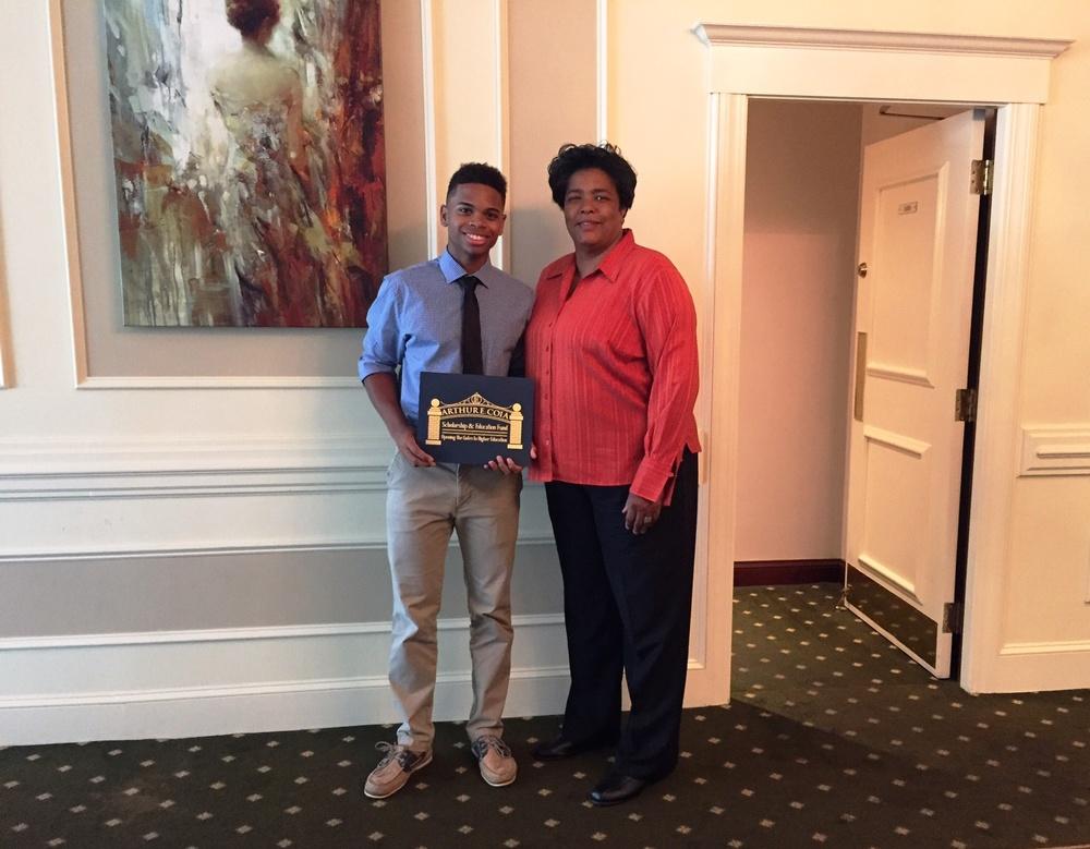 Business Manager Karen Hazard with scholarship recipient, Aaron A'Avant