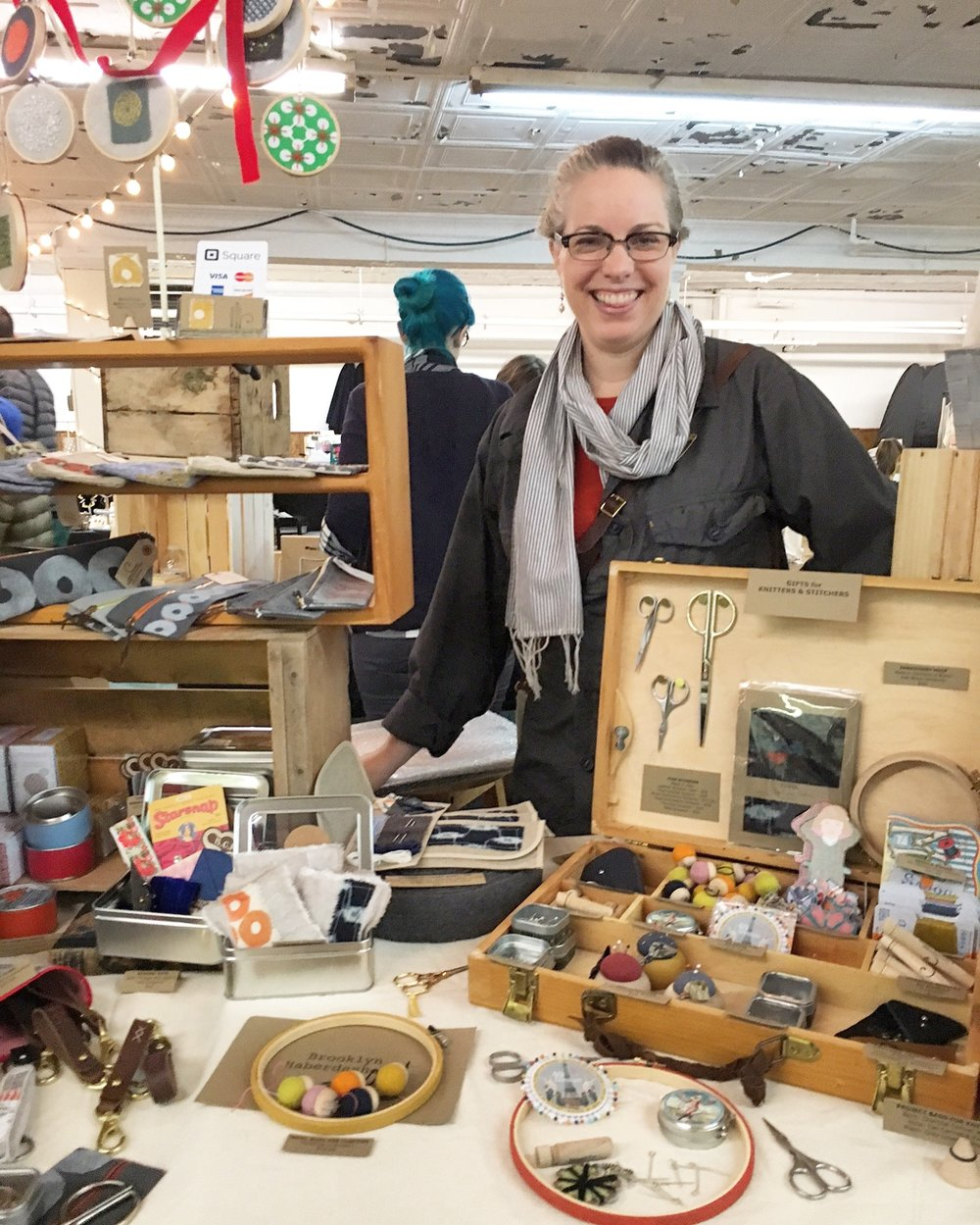 Kristin, Founder + Maker  selling her wares at a pop-up market