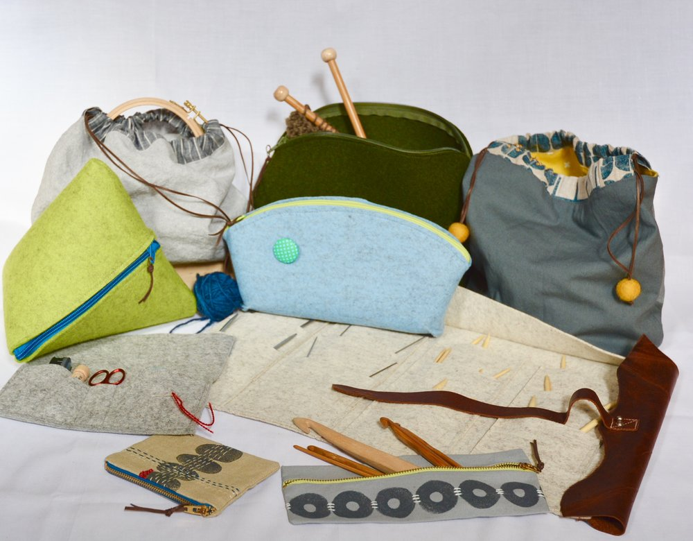 PROJECT BAGS and CASES  Back Row (l to r) Sasha Project Bag -- $32, Subway Stitcher Project Bag --$45, Berit Project Bag -- $65; Third Row (l to r) Wool Pyramid Project Bag -- $40, Wool Pod -- $36; Second Row (l to r) Uta Notions Clutch -- $45, Ursula Case for Circular Knitting Needles -- $95; Front Row (l to r) Linen Notions Pouch -- $32, Linnea Pouch for Crochet Hooks or Notions -- $28