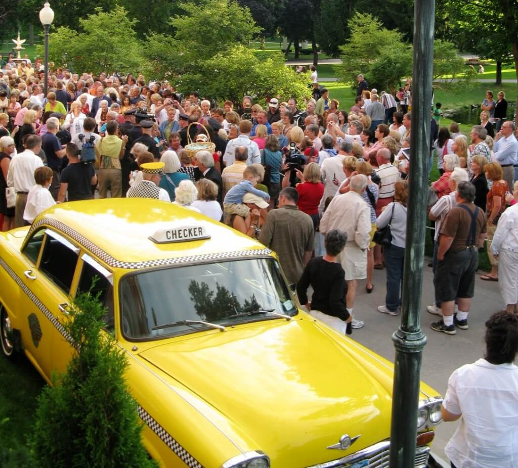 Crowd swarms into Congress Park during Whitney gala in 2010. Whitney and Hendricson arrived by Checker Cab