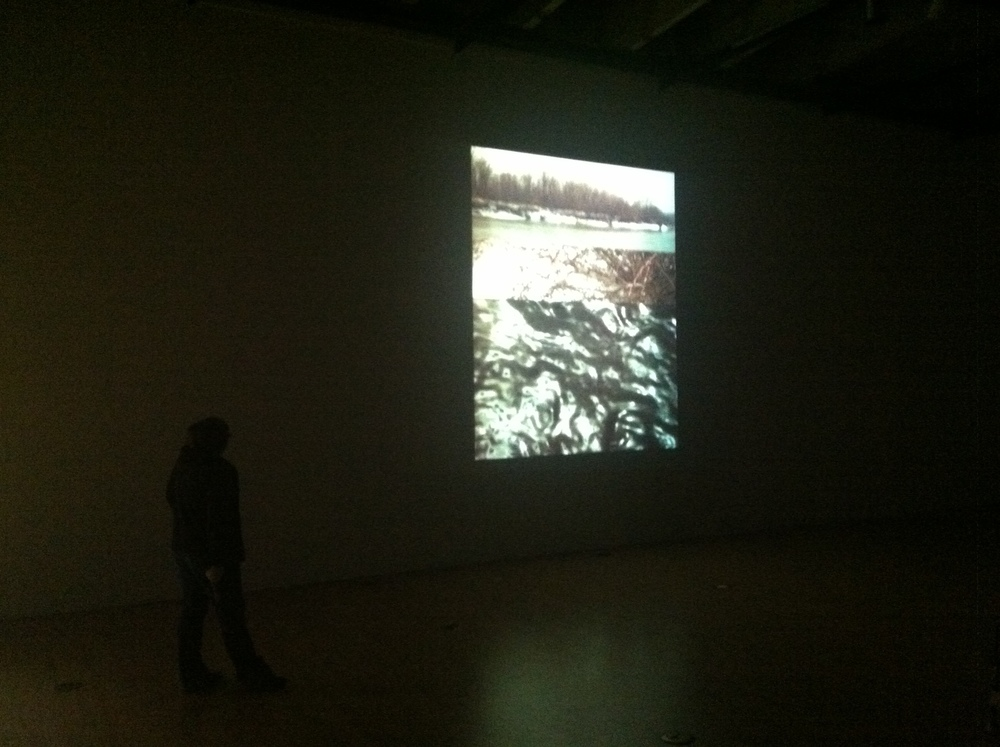 "Installation of ""Outbound, Looking Back,"" video projection, 2013.   Click on image to view youtube video."