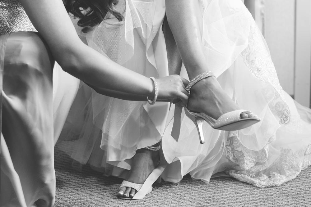 Bride gets ready for her wedding in a fabulous Stella York wedding dress