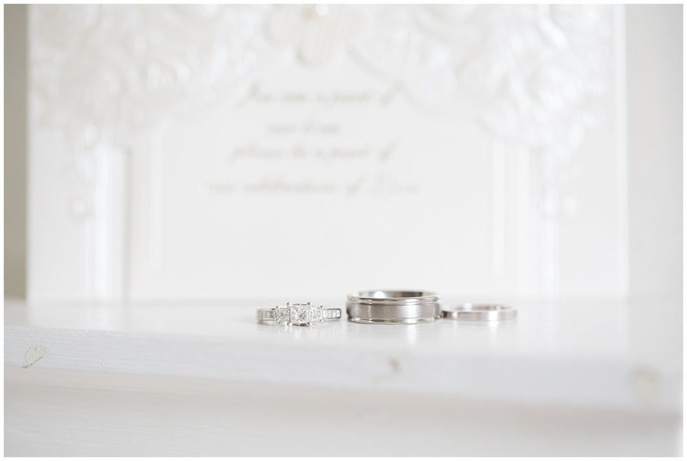Wedding invitation and wedding rings photograph in Calgary