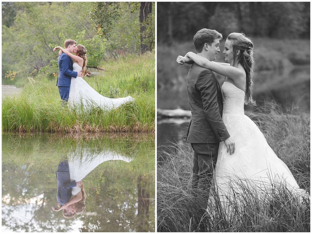 Calgary wedding photograph of couple kissing reflection in pond