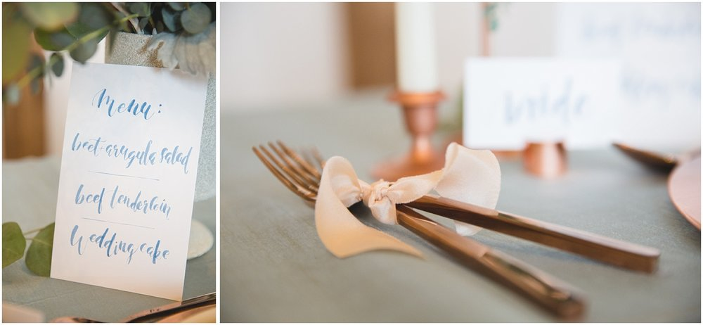 Styled wedding table decor with copper cutlery, calligraphy, and white candles