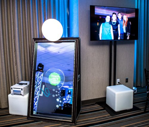 Mirror Booth - Mirror Booth includes... 1 Mirror BoothUnlimited photo sessions for the hours booked2 Large photo prints 4
