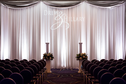 Pipe & Drape Backdrops - Pipe & drape is so versatile. It can transform any space, creating a clean look while creating seamless wall transitions. Use it to cover windows, doors, or unsightly walls. Pipe and drape can also create a visually clean backdrop for wedding altars, head tables, cake tables, food stations and more.