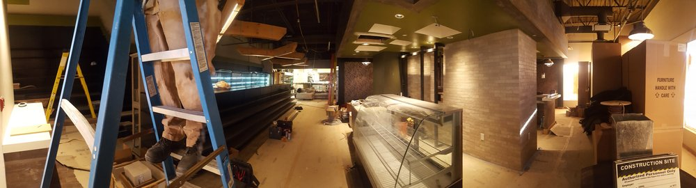 Panoramic view of Agora Fine Foods and Bistro & Wine Bar nearing completion.