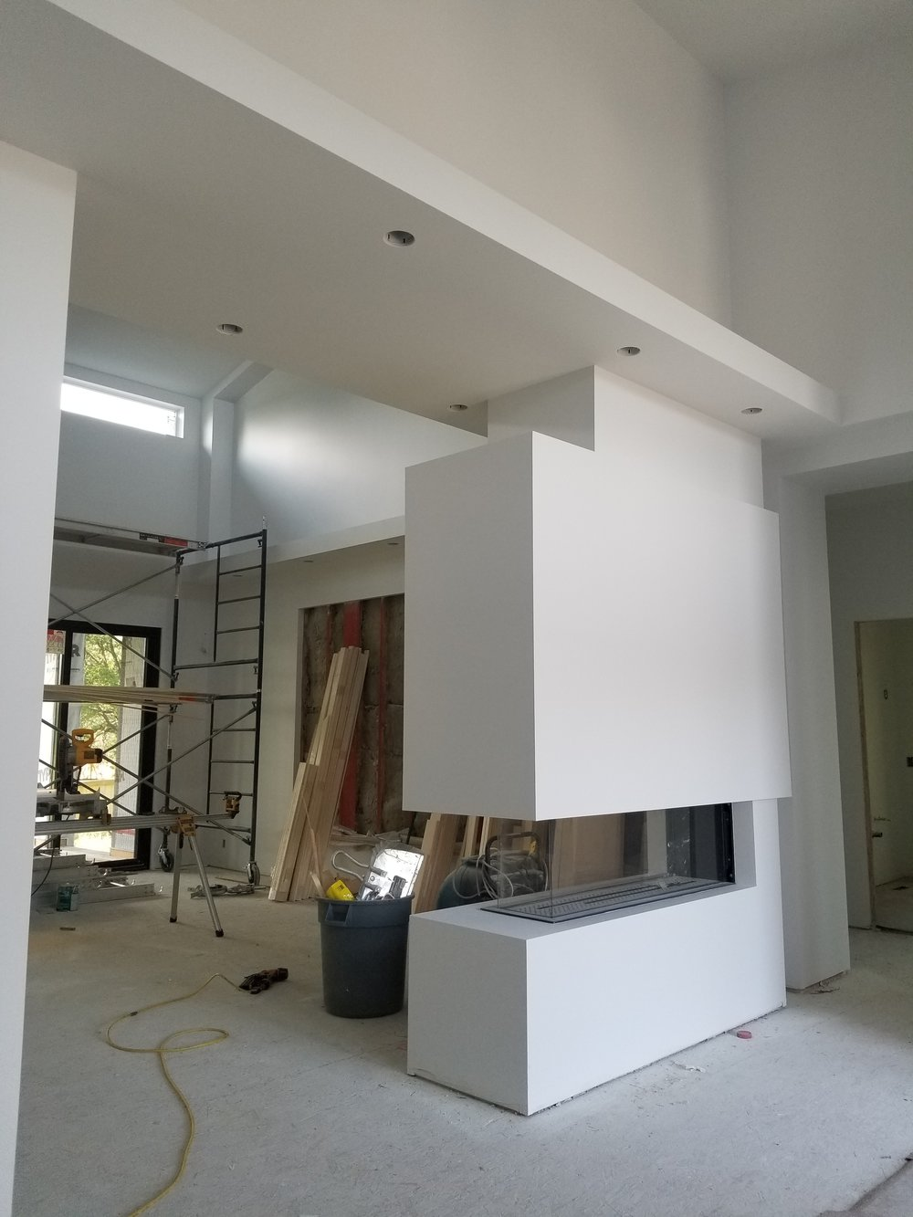 - View from the front Foyer Featuring Room Divider Fireplace