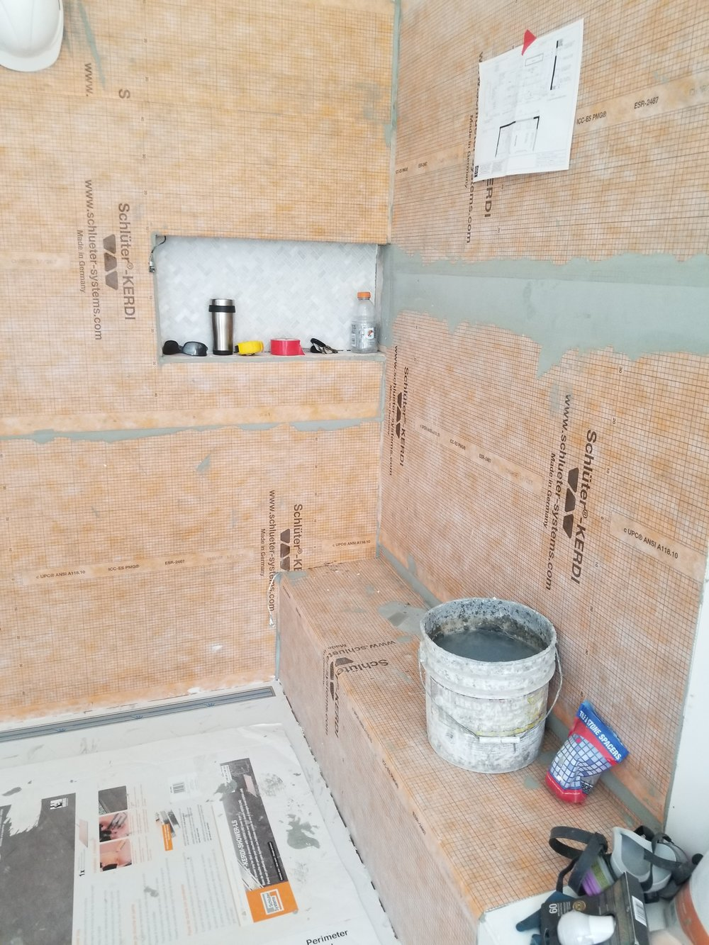 Shower Layers - I just got back from Schluter workshops which included learning about Schluter Kerdi shower membranes and proper installation methods. It's great to see it going into a project!