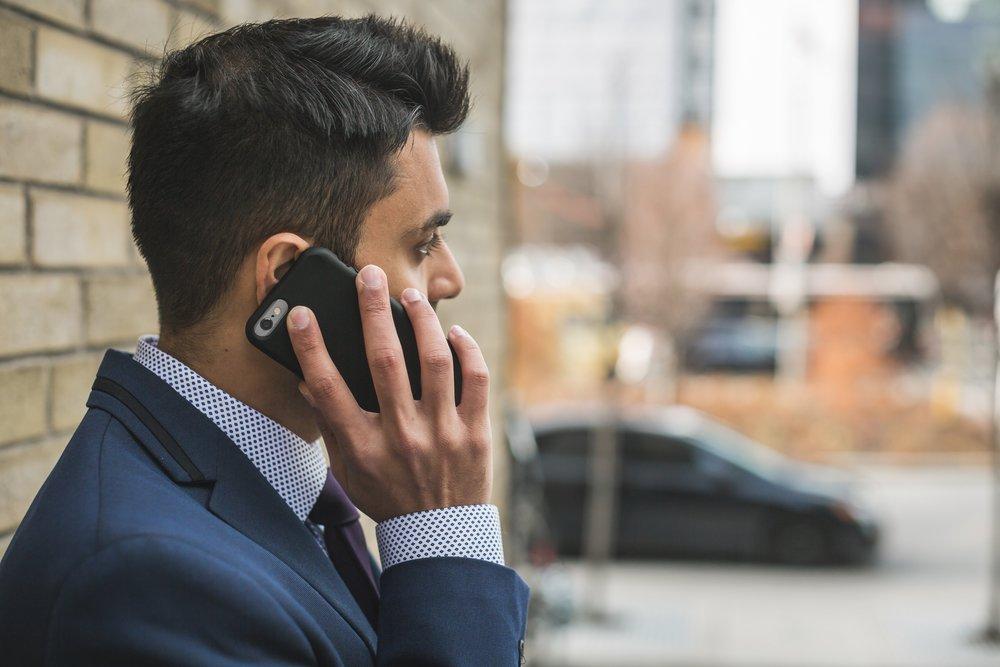 man-talking-on-cellphone_4460x4460.jpeg