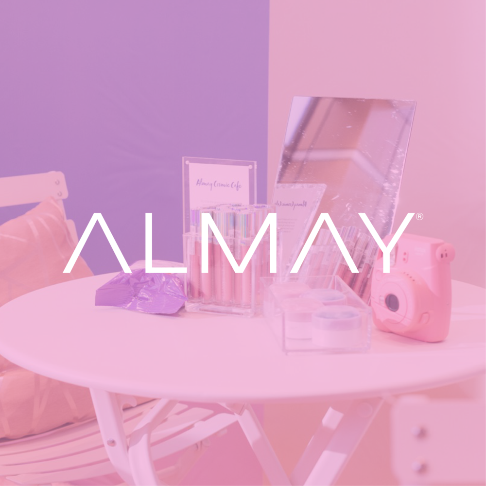 Almay - Visit the Almay Cosmic Café to discover the latest trend in holographic makeup: Cosmic Lip Gloss. Introducing the NEW Almay Goddess Gloss™. In just one swipe, Almay Goddess Gloss™ takes your look from zero to infinity… and beyond!