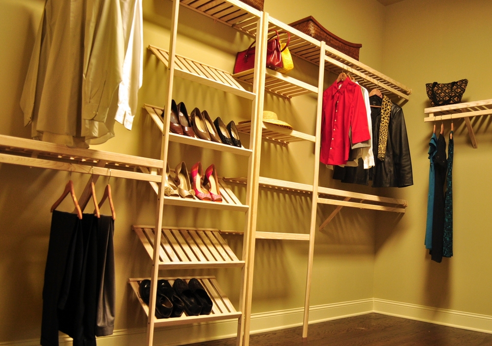 Closet with slanted shoe shelf