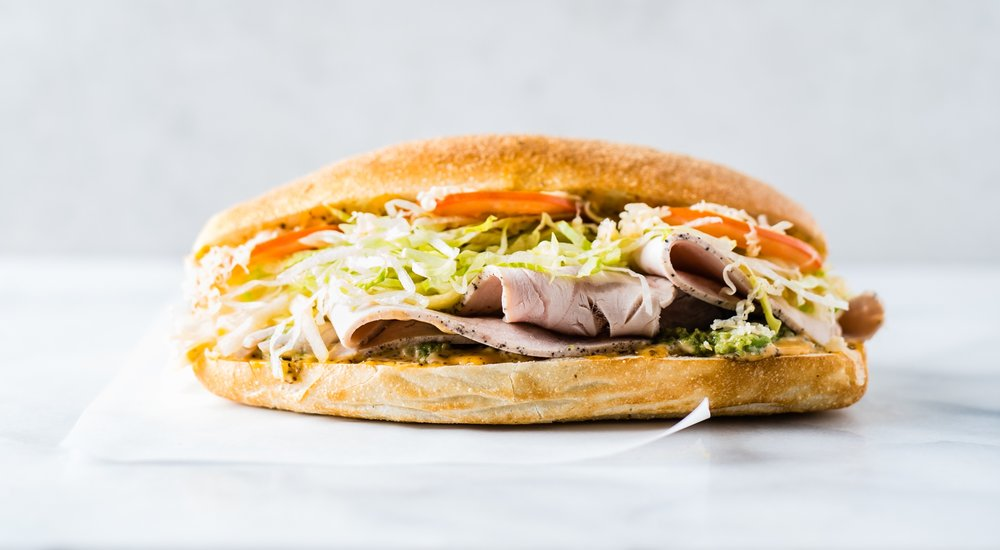 Turkey + Gouda - SLOW ROASTED TURKEY, SMOKED GOUDA, AVOCADO, PICKLED APPLE, LETTUCE, TOMATO, CHILE-CELERY MAYO, SUB ROLL - $10.95