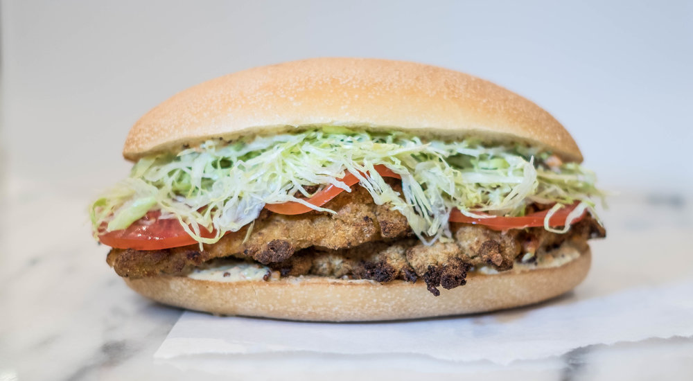 Shake + Make - PARMIGIANO-HERB CRUSTED CHICKEN, LETTUCE, TOMATO, GARLIC REMOULADE,SUB ROLL - $9.95