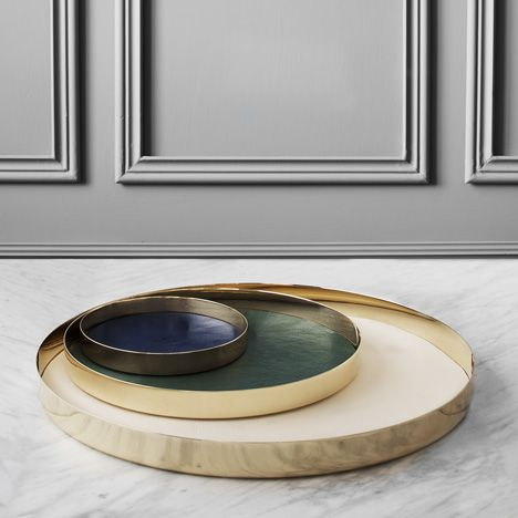 Spun-brass trays with leather inlay
