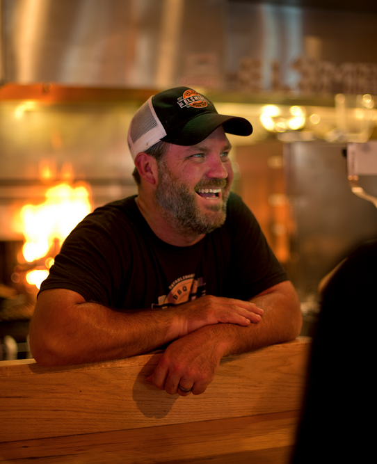 JEREMY RUSH Owner/Chef Jeremy Rush is Adam's longtime friend and culinary collaborator. Together they have over 40 years combined experience in the business. Jeremy's BBQ interest began with fond childhood memories of roadside barbecue restaurants encountered during annual family-visits to Kansas. BBQ is a family tradition for Jeremy whose father used to pull out the smoker for holidays and family gatherings. His love of BBQ has stayed with him over the years and he is proud to share this passion for delicious BBQ with you. FUN FACT:Jeremy grew up in Freeport, Maine and attended North Yarmouth Academy where he was the captain of the varsity Hockey Team.