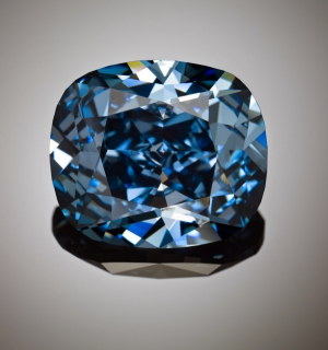 The Blue Moon of Josephine - 12.03-carat fancy vivid blue internally flawless diamond sold in Nov 2015 for 48.4m USD. at Sotheby's. The spectacular blue diamond sold for a world record price.