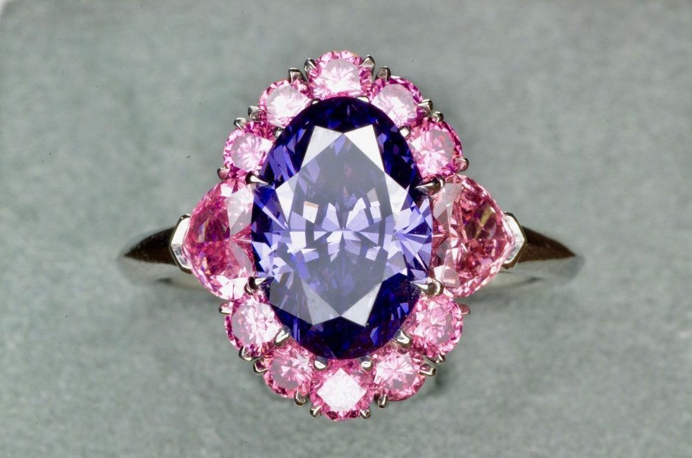 The Argyle Violet Diamond set in a beautiful platinum diamond setting surrounded by 12 rare vivid pink diamonds. On display at the Natural History Museum of Los Angeles