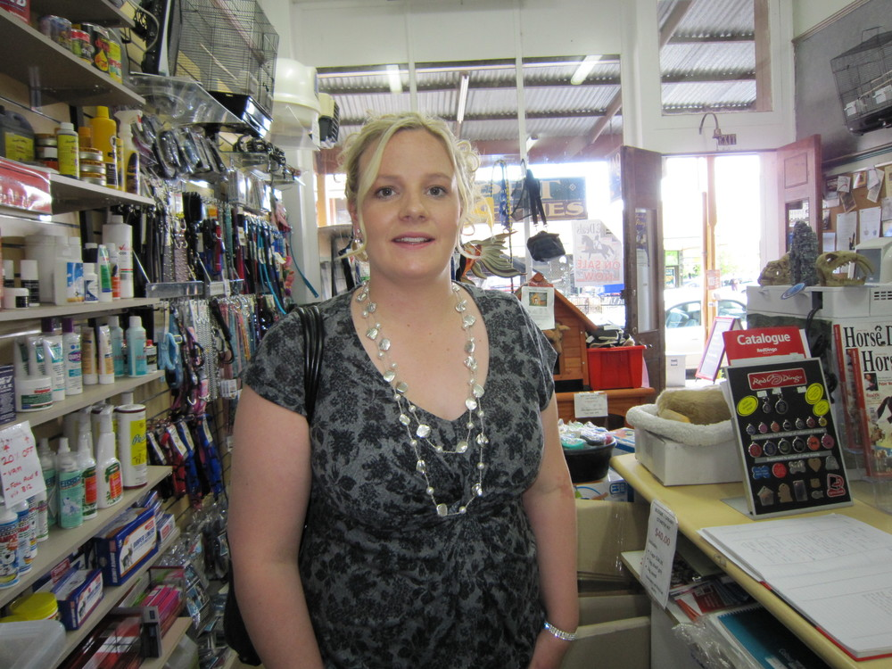 Not a normal day in the shop. Elise farewells staff as she prepares to meet the Queen at Government House in 2011.