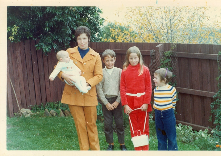 I felt very smart in my red pantsuit made by my very talented dressmaker mother.
