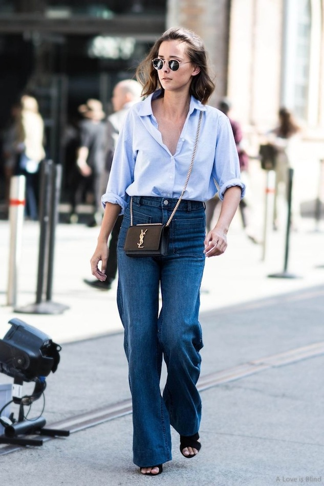 Le-Fashion-Blog-Eleanor-Pendleton-Street-Style-Effortless-Blue-Button-Down-Shirt-YSL-Crossbody-Bag-Wide-Leg-Jeans-Via-A-Love-Is-Blind.jpg