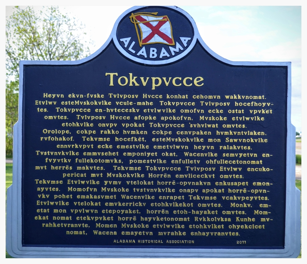 Tukabatcee historical marker reverse side written in Muskogee, Elmore County, Alabama