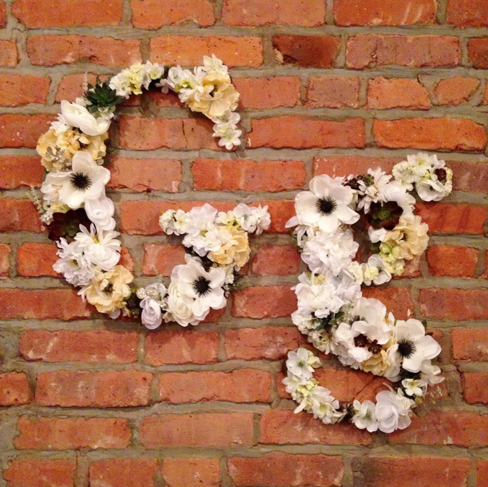 Faux flower typography wall hangings.