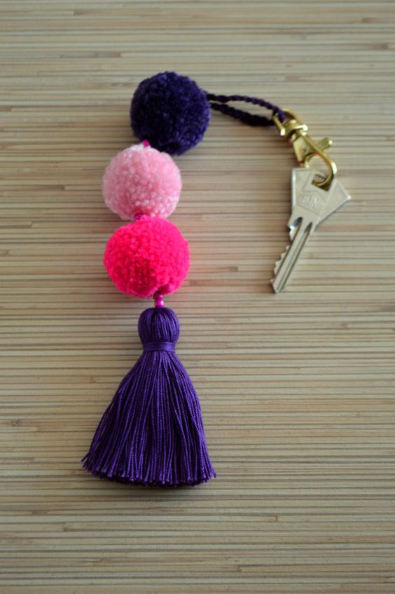 credit: https://www.etsy.com/ru/listing/490626157/pom-pom-keychain-pom-pom-bag-charm?ref=related_listings