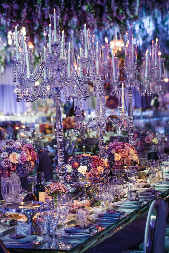 Glass candelabras and purple and lavender wedding floral decor by Eddie Zaratsian Lifestyle and Design, Photo by Jessica Claire
