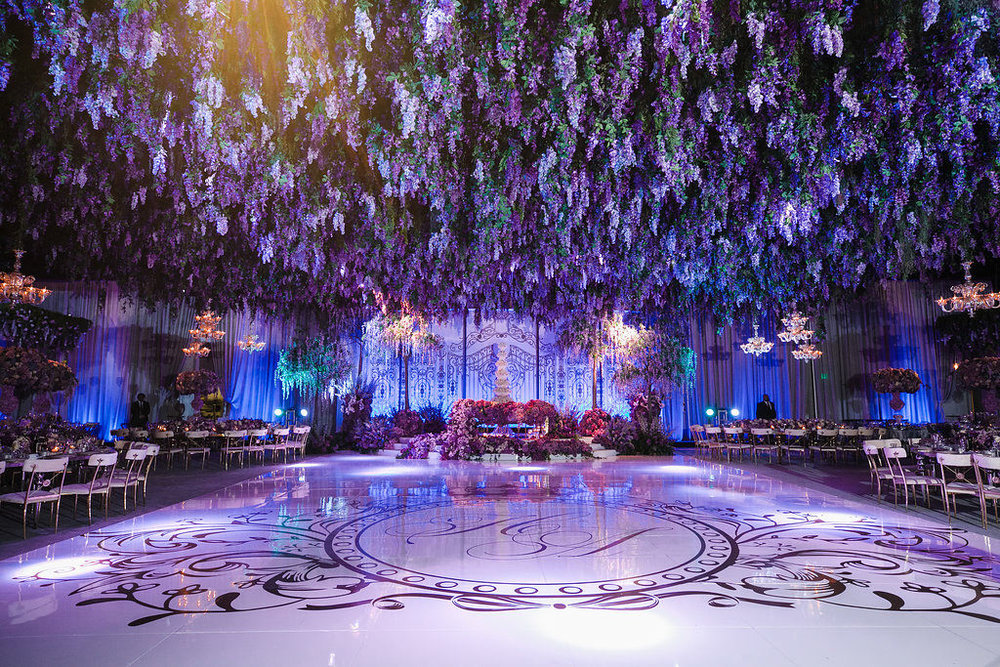 Purple and lavender wisteria draped wedding dance floor designed by Eddie Zaratsian Lifestyle and Design, Photo by Jessica Claire