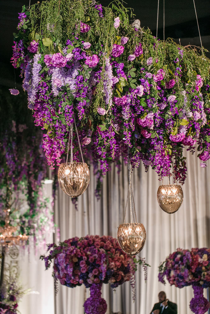 Hanging lanterns and purple wedding floral decor by Eddie Zaratsian Lifestyle and Design, Photo by Jessica Claire