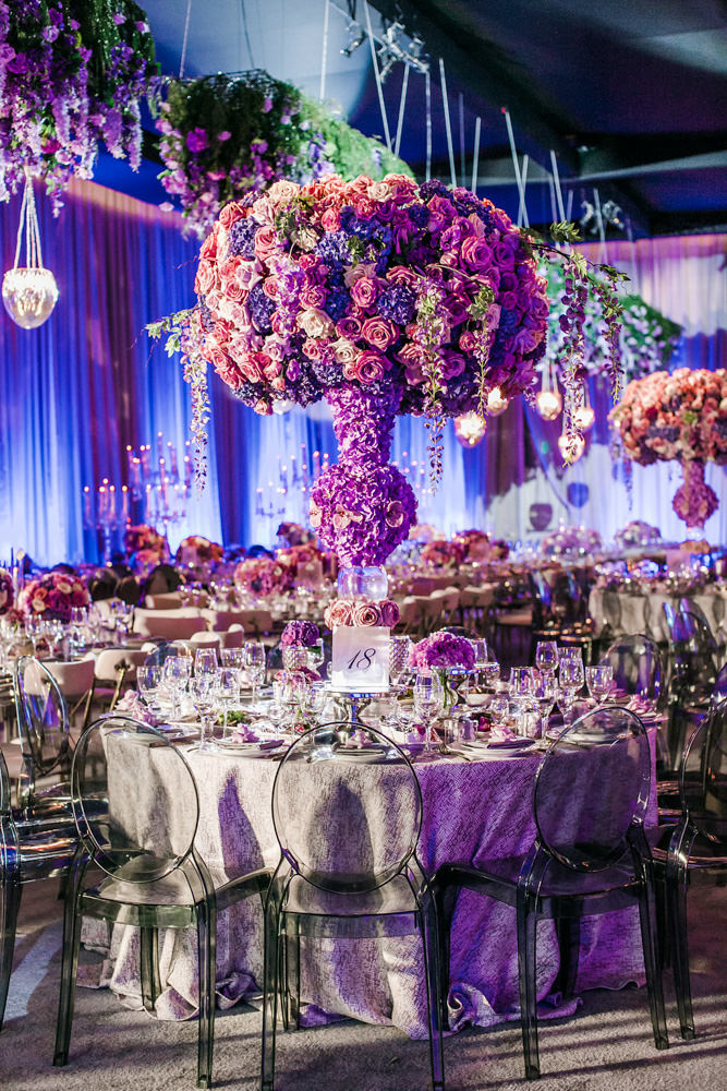Purple wedding reception floral centerpiece with flower covered vase, Designed by Eddie Zaratsian Lifestyle and Design, Photo by Jessica Claire