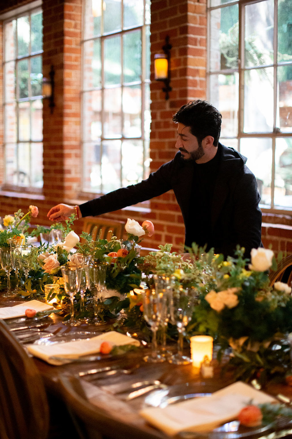 Eddie Zaratsian creating a rustic dinner party table scape for the Allison Webb Spring 2019 Bridal Collection, Photo by Jessica Grazia Mangia Photography